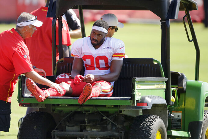 Kansas City Chiefs cornerback Keith Reaser (20) is carted off the field after being injured during NFL football training camp Monday, July 29, 2019, in St. Joseph, Mo. (AP Photo/Charlie Riedel)