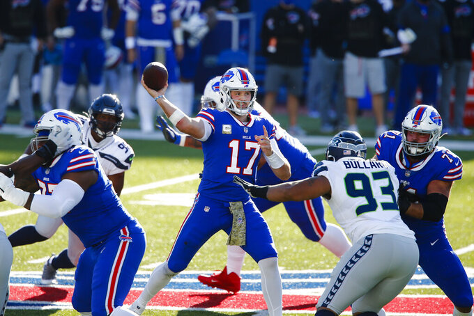 Buffalo Bills quarterback Josh Allen (17) looks to throw a pass during the first half of an NFL football game against the Seattle Seahawks, Sunday, Nov. 8, 2020, in Orchard Park, N.Y. (AP Photo/John Munson)