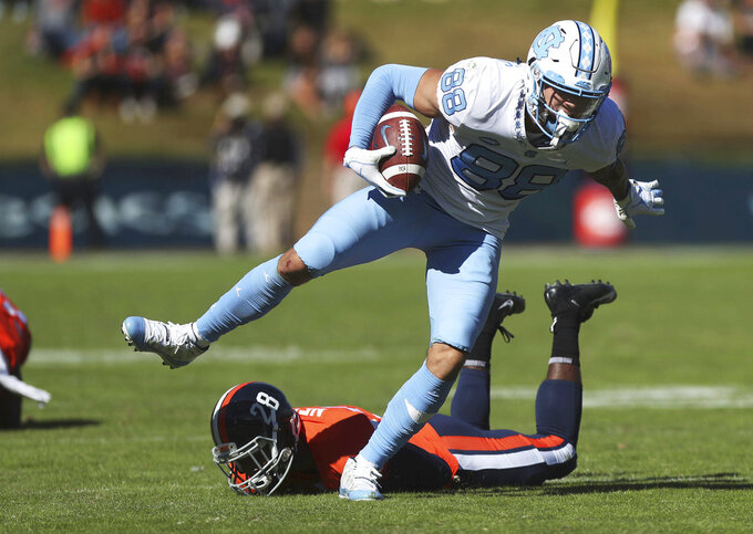 North Carolina's Beau Corrales (88) breaks a tackle from Virginia's free safety Brenton Nelson (28) during the first half of an NCAA college football game Saturday, Oct. 27, 2018, in Charlottesville, Va. (Zack Wajsgras /The Daily Progress via AP)