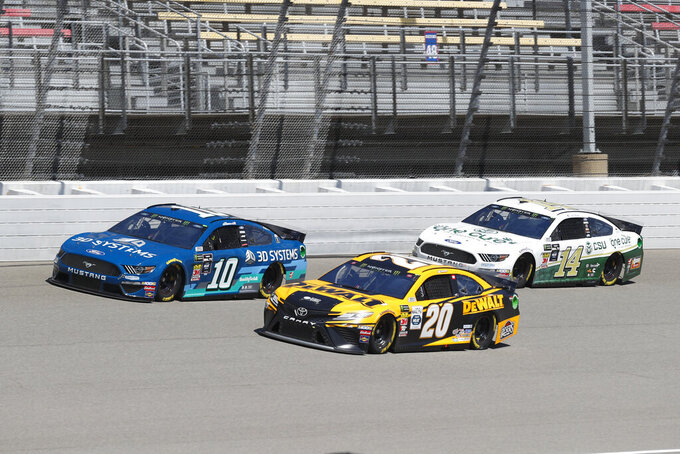 Aric Almirola (10), Erik Jones (20) and Clint Bowyer (14) practice for a NASCAR Cup Series auto race at Michigan International Speedway in Brooklyn, Mich., Saturday, Aug. 10, 2019. (AP Photo/Paul Sancya)