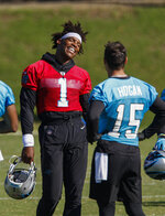 Carolina Panthers quarterback Cam Newton (1) laughs with wide receiver Chris Hogan (15) during an NFL football team practice in Charlotte, N.C., Tuesday, June 11, 2019. (AP Photo/Nell Redmond)