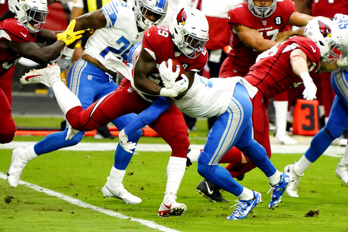 Arizona Cardinals running back Chase Edmonds (29) is tackled by Detroit Lions defensive back Tracy Walker during the first half of an NFL football game, Sunday, Sept. 27, 2020, in Glendale, Ariz. (AP Photo/Rick Scuteri)