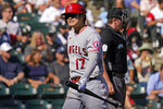 Los Angeles Angels designated hitter Shohei Ohtani, of Japan, reacts as he walks back to the dugout after striking out swinging during the seventh inning of a baseball game against the Chicago White Sox in Chicago, Thursday, Sept. 16, 2021. (AP Photo/Nam Y. Huh)
