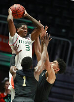 Miami guard Anthony Lawrence II (3) passes past Pittsburgh guard Xavier Johnson (1) and guard Trey McGowens during the second half of an NCAA college basketball game, Tuesday, March 5, 2019, in Coral Gables, Fla. Miami defeated Pittsburgh 76-63. (AP Photo/Wilfredo Lee)