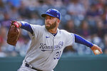 Kansas City Royals starting pitcher Danny Duffy winds up during the first inning of the team's baseball game against the Cleveland Indians, Thursday, July 8, 2021, in Cleveland. (AP Photo/Tony Dejak)