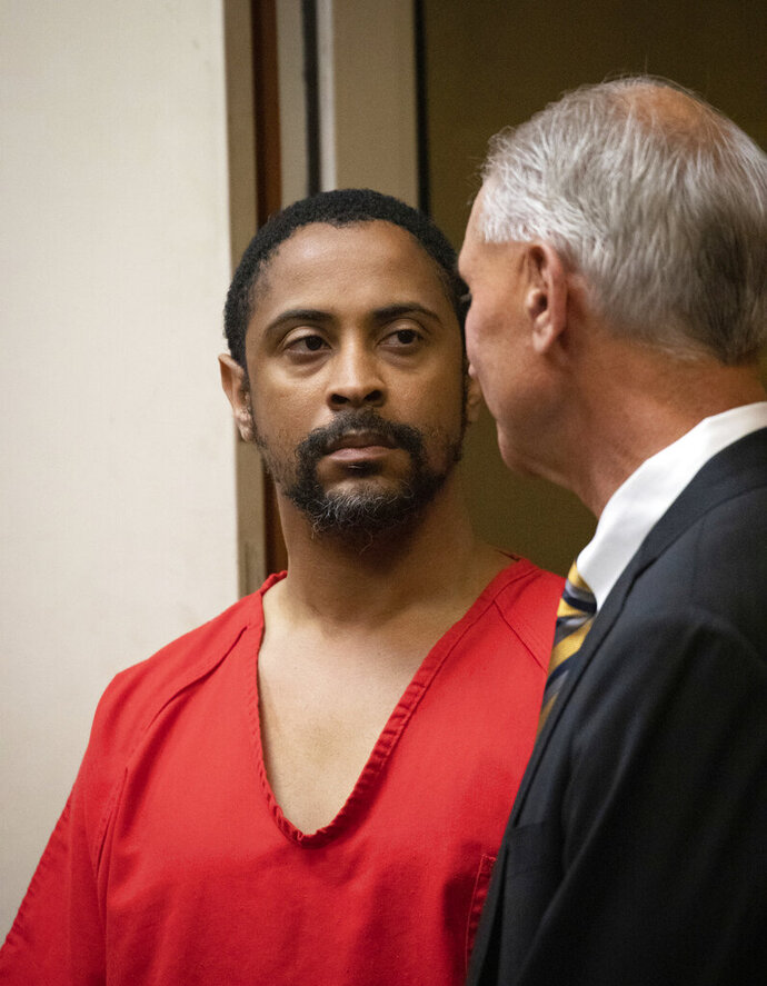 Isaiah J. Peoples appears for his arraignment in Santa Clara County Superior Court as his lawyer, Chuck Smith, stands at his side on Friday, April 26, 2019, in San Jose, Calif. The former U.S. Army sharpshooter Peoples is charged with eight counts of attempted murder after authorities say he deliberately plowed his car into pedestrians Tuesday. (Jim Gensheimer/San Francisco Chronicle via AP, Pool)