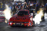 In this photo provided by the NHRA, Matt Hagan takes part in Funny Car qualifying at the Dodge//SRT Mile-High NHRA Nationals drag races Friday, July 16, 2021, at :Bandimere Speedway in Morrison, Colo. (Richard H Shute/NHRA via AP)