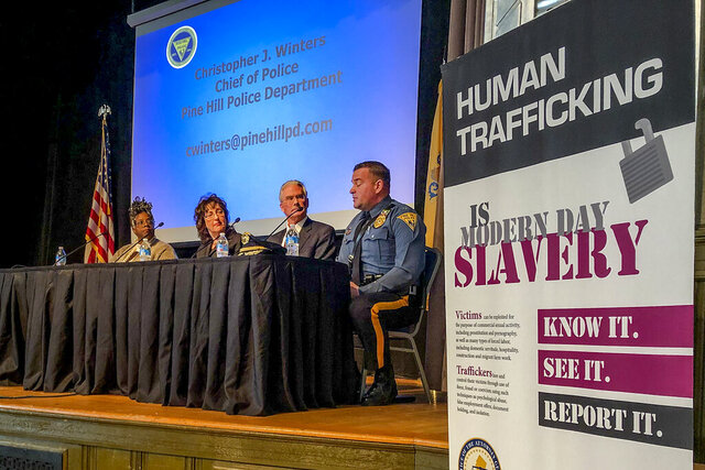 Panelists at the New Jersey attorney general's annual human trafficking awareness event talk about how to prevent the crime, Friday, Jan. 24, 2020, in Trenton, N.J. New Jersey has failed over the past five years to fully carry out a law aimed at preventing human trafficking by skipping a requirement to issue annual reports on prevention efforts. Commissioners say it's because there are too many vacancies on the commission. (AP Photo/Mike Catalini)