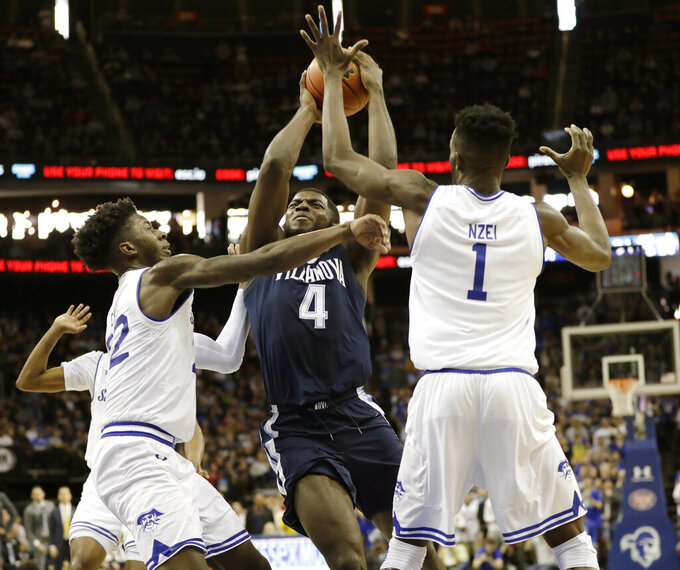 Seton Hall guard Myles Cale (22) and Seton Hall forward Michael Nzei (1) block Villanova forward Eric Paschall (4) as Paschall goes toward the basket during the first half an NCAA college basketball game, Saturday, March 9, 2019, in Newark, NJ. (AP Photo/Kathy Willens)