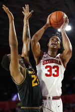 Georgia forward Nicolas Claxton (33) shoots while defended by Missouri forward Kevin Puryear (24) during an NCAA college basketball game Wednesday, March 6, 2019, in Athens, Ga. (Joshua L. Jones/Athens Banner-Herald via AP)