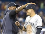 New York Yankees' Gio Urshela celebrates with C.C. Sabathia after the Yankees defeated the Toronto Blue Jays 12-6 in a baseball game Thursday, Aug. 8, 2019, in Toronto. (Fred Thornhill/The Canadian Press via AP)