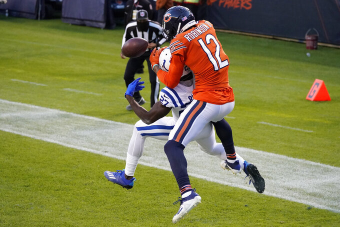 Indianapolis Colts' Xavier Rhodes (27) breaks up a pass intended for Chicago Bears' Allen Robinson (12) during the second half of an NFL football game Sunday, Oct. 4, 2020, in Chicago. (AP Photo/Nam Y. Huh)