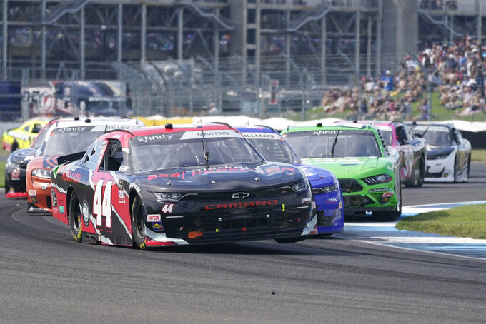 Tommy Joe Martins drives into a turn during a NASCAR Xfinity Series auto race at Indianapolis Motor Speedway, Saturday, Aug. 14, 2021, in Indianapolis. (AP Photo/Darron Cummings)