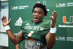 Miami starting quarterback D'Eriq King speaks with the news media after a NCAA college football practice, Tuesday, Aug. 31, 2021, in Coral Gables, Fla.(AP Photo/Lynne Sladky)