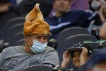 A fan wears a turkey-styled hat as he watches the Washington Football Team and Dallas Cowboys play in the first half of an NFL football game in Arlington, Texas, Thursday, Nov. 26, 2020. (AP Photo/Ron Jenkins)