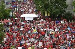 Educators fill Bicentennial Plaza during a teachers rally at the General Assembly in Raleigh, N.C., Wednesday, May 16, 2018. Thousands of teachers rallied the state capital seeking a political showdown over wages and funding for public school classrooms. (AP Photo/Gerry Broome)
