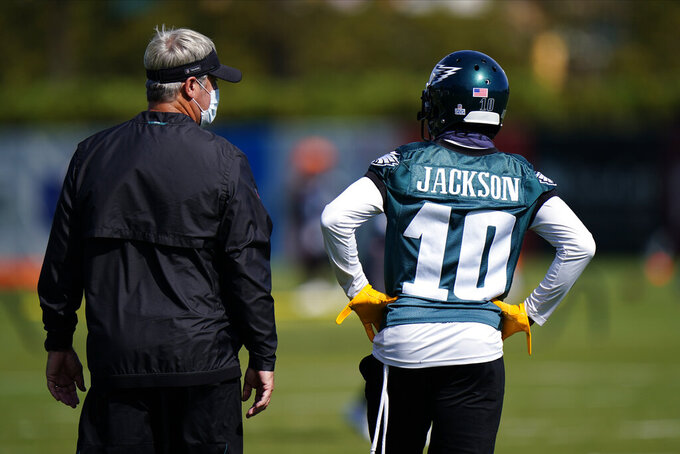 Philadelphia Eagles' Doug Pederson, left, and DeSean Jackson talk during practice at the NFL football team's training facility, Thursday, Oct. 15, 2020, in Philadelphia. (AP Photo/Matt Slocum, Pool)