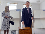 Czech Prime Minister Andrej Babis, right, and his wife Monika Babisova, left, cast their votes in the European elections in Pruhonice near Prague, Czech Republic, Friday May 24, 2019. (/Michaela Rihova/CTK via AP)