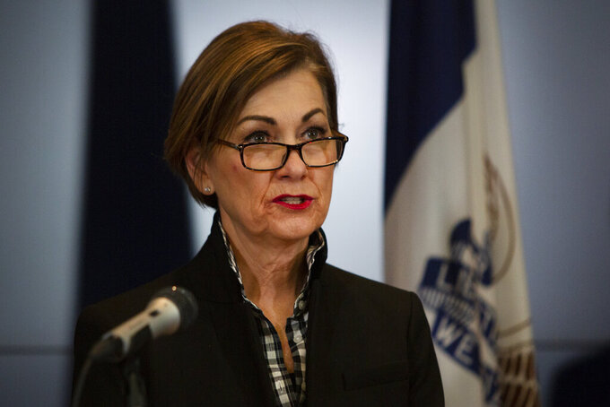 Iowa Gov. Kim Reynolds announces updates on COVID-19 at a news conference on Tuesday, March 31, 2020, at the State Emergency Operations Center in Johnston, Pa. (Olivia Sun/The Des Moines Register via AP, Pool)