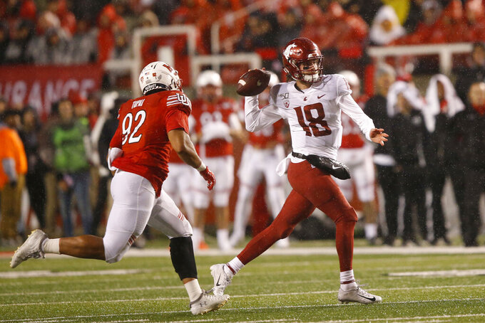 Utah defensive end Maxs Tupai (92) pursues Washington State quarterback Anthony Gordon (18) in the first half of an NCAA college football game Saturday, Sept. 28, 2019, in Salt Lake City. (AP Photo/Rick Bowmer)