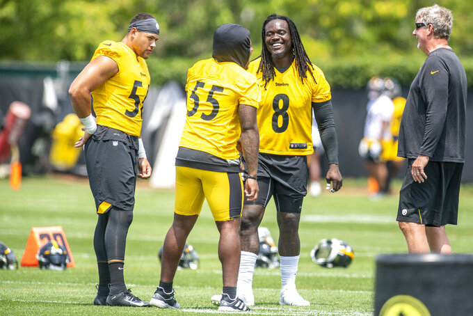 Steelers linebackers Alex Highsmith (56), Devin Bush (55), and Melvin Ingram (8) talk and laugh during training camp, Saturday, July 24, 2021, at the UPMC Rooney Sports Complex on the South Side in Pittsburgh. (Alexandra Wimley/Pittsburgh Post-Gazette via AP)