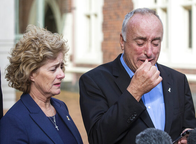 Parents of murdered British backpacker Grace Millane, Dave and Gillian react as they speak to the media outside the High Court, in Auckland, New Zealand, Friday, Nov. 22, 2019. A New Zealand jury found a man guilty of murder in the death of the 22-year-old British backpacker. (Jason Oxenham/New Zealand Herald via AP)