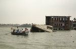 In this Tuesday, Sept. 17, 2019, file photo, people move on boats past submerged houses by the River Ganges in Prayagraj, India. Heavy monsoon rains have raised the water levels of the Ganges River above the danger level, triggering evacuation of thousands of people from flooded homes around the area. (AP Photo/Rajesh Kumar Singh, File)