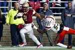 Boston College running back AJ Dillon (2) breaks a tackle byMiami linebacker Zach McCloud (53) on a touchdown run during the second half of an NCAA college football game in Boston, Friday, Oct. 26, 2018. (AP Photo/Michael Dwyer)