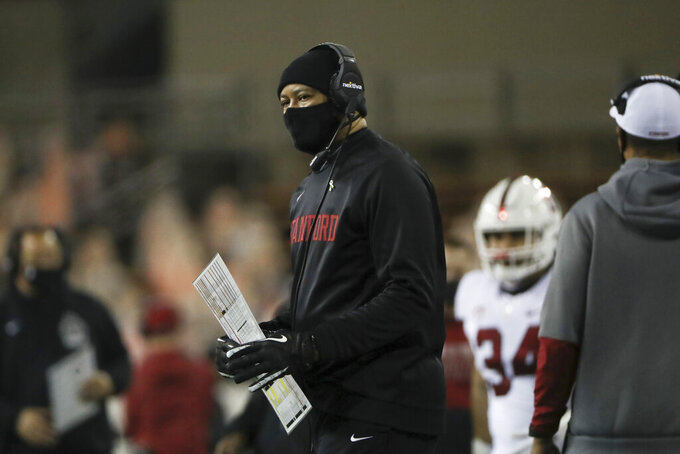 Stanford coach David Shaw watches during the first half of the team's NCAA college football game against Oregon State in Corvallis, Ore., Saturday, Dec. 12, 2020. (AP Photo/Amanda Loman)