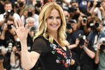 """FILE - In this May 15, 2018, file photo, actress Kelly Preston poses for photographers during a photo call for the film 'Gotti' at the 71st international film festival, Cannes, southern France.  Actress Kelly Preston, whose credits included the films """"Twins"""" and """"Jerry Maguire,"""" died Sunday, July 12, 2020, her husband John Travolta said. She was 57.(Photo by Arthur Mola/Invision/AP, File)"""