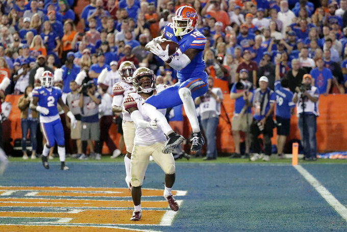 FILE - In this Nov. 30, 2019, file photo, Florida wide receiver Van Jefferson (12) catches a 13-yard touchdown pass in front of Florida State defensive back Levonta Taylor (1) during the first half of an NCAA college football game in Gainesville, Fla. Jefferson was chosen by the Los Angeles Rams in the second round of the NFL football draft Friday, April 24, 2020. (AP Photo/John Raoux, File)
