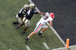 Georgia tight end Brock Bowers (19) scores his second touchdown of the game as he gets past Vanderbilt defenders Chase Lloyd (4) and Allan George (28) in the first half of an NCAA college football game Saturday, Sept. 25, 2021, in Nashville, Tenn. (AP Photo/Mark Humphrey)