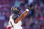 California running back Christopher Brown Jr. (34) celebrates after scoring a touchdown against Stanford during the first half of an NCAA college football game Saturday, Nov. 23, 2019 in Stanford, Calif. (AP Photo/Tony Avelar)