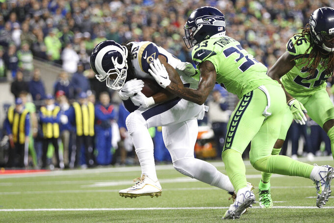 Los Angeles Rams running back Todd Gurley (30) carries the ball in an NFL game against the Seattle Seahawks, Thursday, Oct. 3, 2019, in Seattle. The Seahawks defeated the Rams 30-29. (Margaret Bowles via AP)