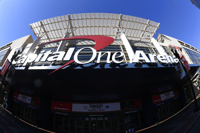 In this photograph taken with a fisheye lens, the exterior view of Capital One Arena is seen, Saturday, March 16, 2019, in Washington. As the NCAA prepares to stage its first basketball championships since the Supreme Court allowed legal sports betting in any state that wants it, the organization remains opposed to gambling on its events. But it's not denying reality, either. The NCAA had a longtime ban on bringing its championships to places where gambling on sports was legal. That was suspended last year in the wake of the Supreme Court decision. This year, three women's games will be played in Mississippi, where people have been betting on college sports since last summer, and men's games will be played in Washington at Capital One Arena, which could have a full-service onsite sportsbook by this time next year under a new law.  (AP Photo/Nick Wass)