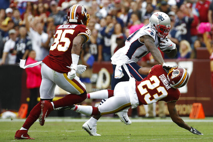 New England Patriots wide receiver Josh Gordon (10) runs against Washington Redskins cornerback Quinton Dunbar (23) during the first half of an NFL football game, Sunday, Oct. 6, 2019, in Washington. (AP Photo/Patrick Semansky)