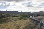 This photo taken Monday, May 12, 2019, off Arizona scenic state Highway 83 shows the eastern slope of the Santa Rita Mountains where Canadian firm Hudbay Minerals Inc. plans an open pit copper mine. Native American tribes and environmental groups have sued to stop it, saying it could harm sacred ancestral land as well as air and water quality, dry up wells and destroy habitat for the endangered jaguar and other species. (AP Photo/Anita Snow)
