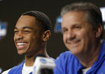 Kentucky's PJ Washington, left, smiles alongside head coach John Calipari during a news conference at the NCAA tournament college basketball tournament Saturday, March 30, 2019, in Kansas City, Mo. Kentucky is set to play Auburn in the Midwest regional final on Sunday. (AP Photo/Jeff Roberson)