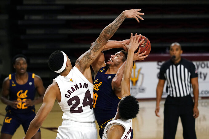 California guard Matt Bradley (20) draws a foul from Arizona State forward Jalen Graham (24) during the second half of an NCAA college basketball game Thursday, Jan. 28, 2021, in Tempe, Ariz. Arizona State won 72-68. (AP Photo/Rick Scuteri)