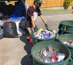 In this June 2021 photo provided by Maria Price,  Genshu Price drops off cans and bottles at a recycling center in Kahaluʻu, Hawaii. Price has recycled over 100,000 cans and bottles to raise money for students' college tuition through his fundraiser, Bottles4College. (Bottles4College via AP)