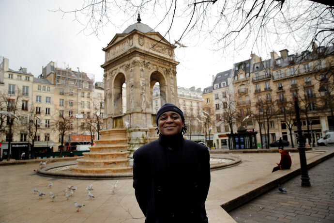 Omer Mas Capitolin poses in Paris, Tuesday Jan.26, 2021. In a first for France, six nongovernmental organizations launched a class-action lawsuit Wednesday against the French government for alleged systemic discrimination by police officers carrying out identity checks. Omer Mas Capitolin, the head of Community House for Supportive Development, a grassroots NGO taking part in the legal action, called it a