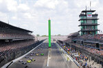 FILE - In this May 27, 2018, file photo, Ed Carpenter leads the field into the first turn on the start of the Indianapolis 500 auto race at Indianapolis Motor Speedway in Indianapolis. The speedway is closed due to the coronavirus pandemic. (AP Photo/R Brent Smith, File)
