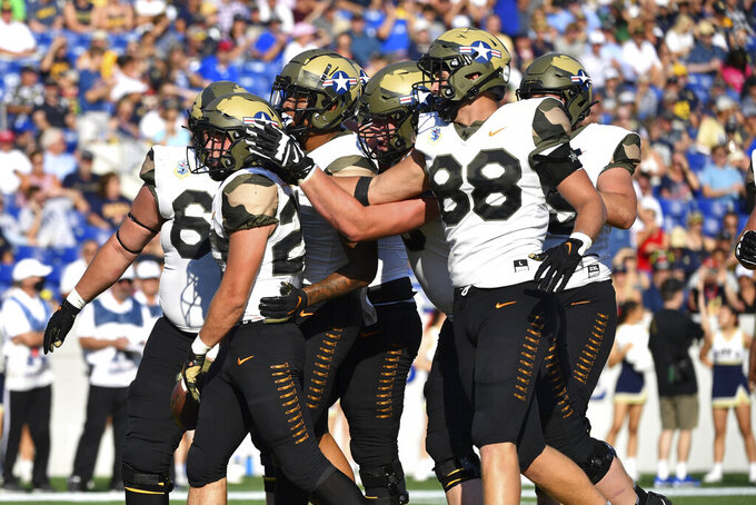 Air Force players celebrate running back Brad Roberts left, first half touchdown during an NCAA college football game Navy, Saturday, Sept. 11, 2021, in Annapolis, Md. (AP Photo/Terrance Williams)