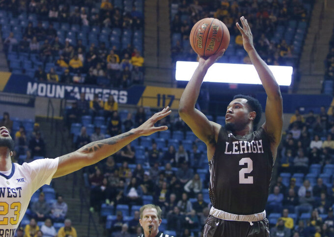 Lehigh guard Kyle Leufroy (2) shoots while defended by West Virginia forward Esa Ahmad (23) during the first half of an NCAA college basketball game Sunday, Dec. 30, 2018, in Morgantown, W.Va. (AP Photo/Raymond Thompson)