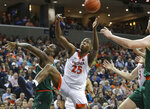 Virginia forward Mamadi Diakite (25) reaches for a loose ball against Miami center Ebuka Izundu (15) during an NCAA college basketball game Saturday, Feb. 2, 2019, in Charlottesville, Va. (AP Photo/Andrew Shurtleff)