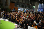 People shout slogans during a march organized by the Fridays for Future international movement of school students at the COP25 climate talks congress in Madrid, Spain, Friday, Dec. 13, 2019. The United Nations Secretary-General has warned that failure to tackle global warming could result in economic disaster. (AP Photo/Manu Fernandez)