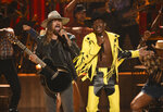 FILE - This June 23, 2019 file photo shows Billy Ray Cyrus, left, and Lil Nas X performing