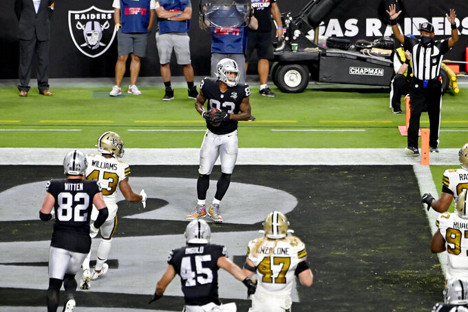 Las Vegas Raiders tight end Darren Waller (83) celebrates after catching a touchdown pass against the New Orleans Saints during the second half of an NFL football game, Monday, Sept. 21, 2020, in Las Vegas. (AP Photo/David Becker)