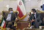 FILE - In this Feb. 20, 2021, file photo, Director General of International Atomic Energy Agency, IAEA, Rafael Mariano Grossi, right, speaks with spokesman of Iran's atomic agency Behrouz Kamalvandi upon his arrival at Tehran's Imam Khomeini airport, Iran. Iran has said it plans to cease its implementation of the