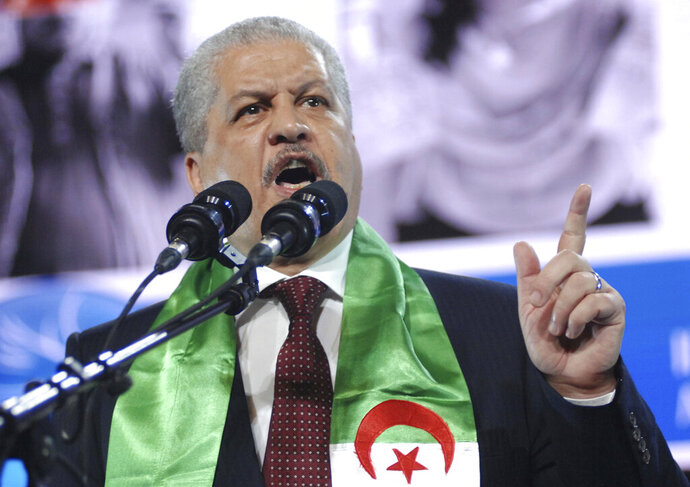 FILE - In this April 13, 2014 file photo, President Abdelaziz Bouteflika's campaign manager, Abdelmalek Sellal, delivers a speech to supporters in Algiers. Former Algerian Prime Minister Abdelmalek Sellal has been jailed in an anti-corruption sweep — the second former head of government in two days to be sent to prison while his case is investigated. (AP Photo/Sidali Djarboub, File)